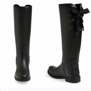 Black coach rain boots with lace up detail